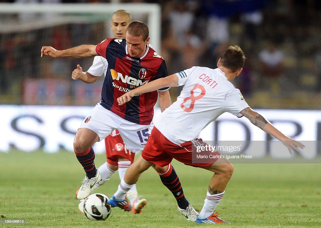<a gi-track='captionPersonalityLinkClicked' href=/galleries/search?phrase=Diego+Perez&family=editorial&specificpeople=697338 ng-click='$event.stopPropagation()'>Diego Perez</a> # 15 of Bologna FC (L) competes the ball with Daniele Corti # 8 of AS Varese during the TIM Cup match between Bologna FC and AS Varese at Stadio Renato Dall'Ara on August 18, 2012 in Bologna, Italy.