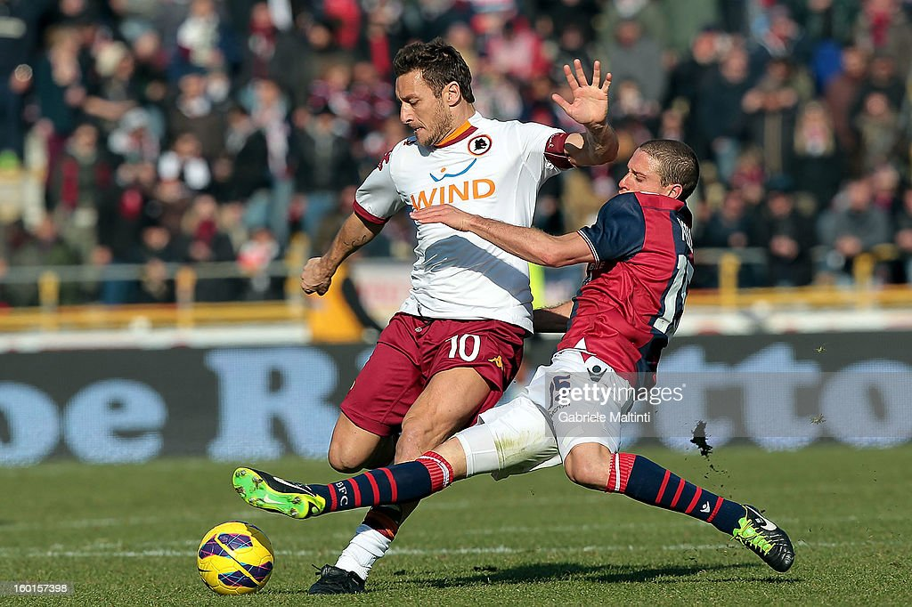 <a gi-track='captionPersonalityLinkClicked' href=/galleries/search?phrase=Diego+Perez&family=editorial&specificpeople=697338 ng-click='$event.stopPropagation()'>Diego Perez</a> of Bologna FC (R) fights for the ball with <a gi-track='captionPersonalityLinkClicked' href=/galleries/search?phrase=Francesco+Totti&family=editorial&specificpeople=208985 ng-click='$event.stopPropagation()'>Francesco Totti</a> of AS Roma during the Serie A match between Bologna FC and AS Roma at Stadio Renato Dall'Ara on January 27, 2013 in Bologna, Italy.