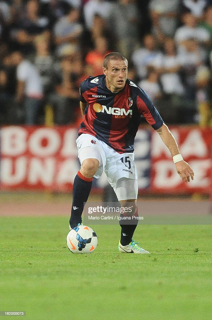 <a gi-track='captionPersonalityLinkClicked' href=/galleries/search?phrase=Diego+Perez&family=editorial&specificpeople=697338 ng-click='$event.stopPropagation()'>Diego Perez</a> # 15 of Bologna FC in action during the Serie A match between Bologna and AC Milan at Stadio Renato Dall'Ara on September 25, 2013 in Bologna, Italy.