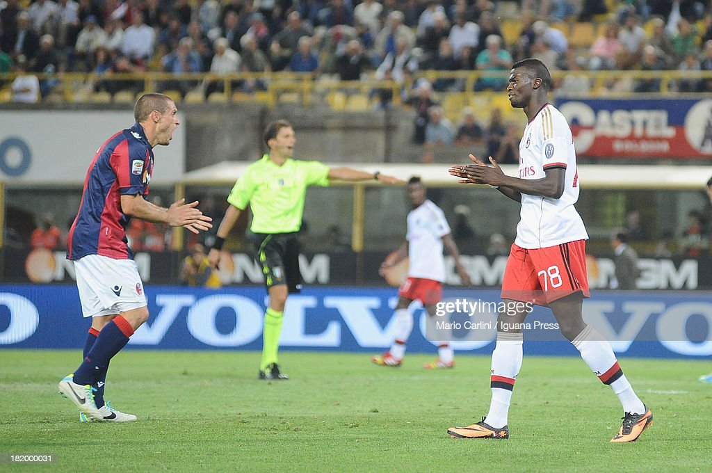 <a gi-track='captionPersonalityLinkClicked' href=/galleries/search?phrase=Diego+Perez&family=editorial&specificpeople=697338 ng-click='$event.stopPropagation()'>Diego Perez</a> # 15 of Bologna FC ( L ) Mbaye Niang # 78 of AC Milan ( R ) react during the Serie A match between Bologna and AC Milan at Stadio Renato Dall'Ara on September 25, 2013 in Bologna, Italy.