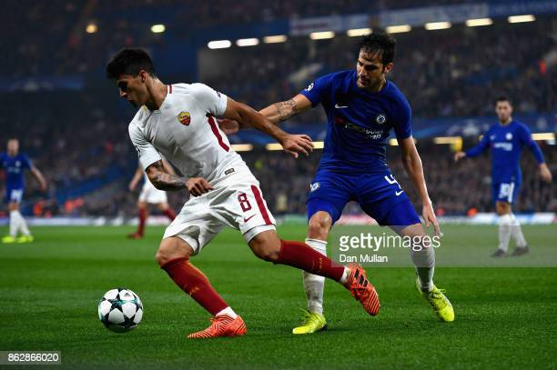 Diego Perotti of AS Roma and Cesc Fabregas of Chelsea battle for possession during the UEFA Champions League group C match between Chelsea FC and AS...