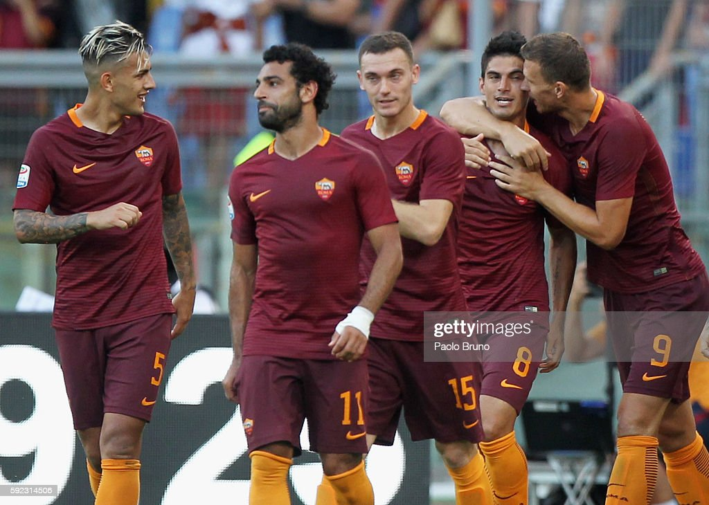 Diego Perotti of AS Roma celebrates with his teammates after scoring the opening goal from the penalty spot during the Serie A match between AS Roma...