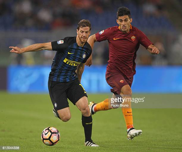 Diego Perotti of AS Roma competes for the ball with Cristian Ansaldi of FC Internazionale during the Serie A match between AS Roma and FC...