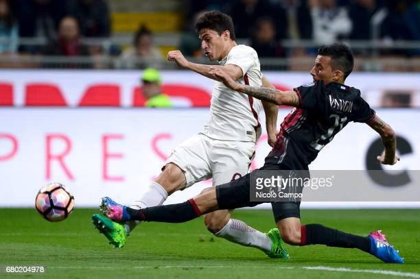 Diego Perotti of AS Roma competes with Leonel Vangioni of AC Milan during the Serie A football match between AC Milan and AS Roma AS Roma wins 41...