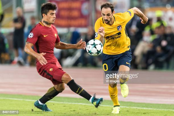 Diego Perotti of AS Roma Juanfran of Club Atletico de Madrid during the UEFA Champions League group C match match between AS Roma and Atletico Madrid...