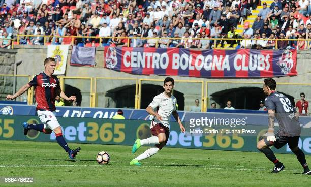 Diego Perotti of AS Roma serves an assist to Edin Dzeko during the Serie A match between Bologna FC and AS Roma at Stadio Renato Dall'Ara on April 9...