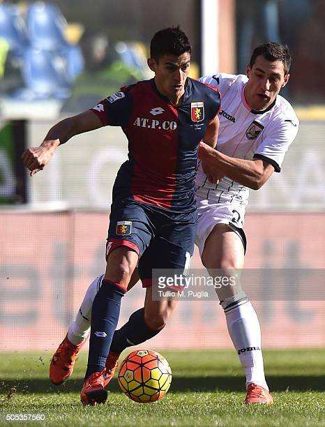 Diego Perotti of Genoa and Mato Jajalo of Palermo compete for the ball during the Serie A match between Genoa CFC and US Citta di Palermo at Stadio...