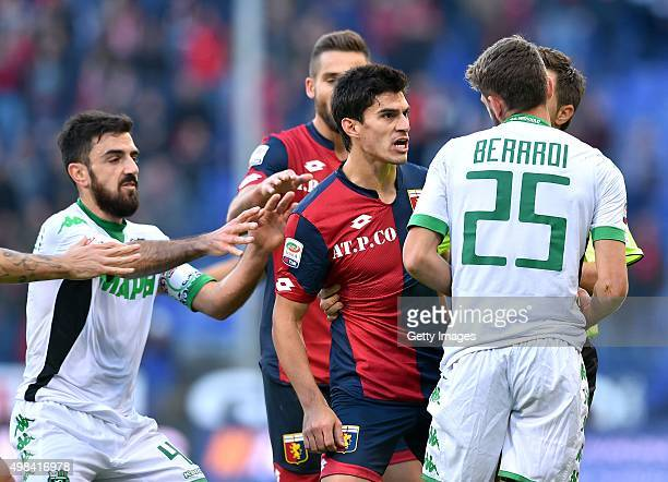 Diego Perotti of Genoa CFC argues with Domenico Berardi of Sassuolo during the Serie A match between Genoa CFC and US Sassuolo Calcio at Stadio Luigi...