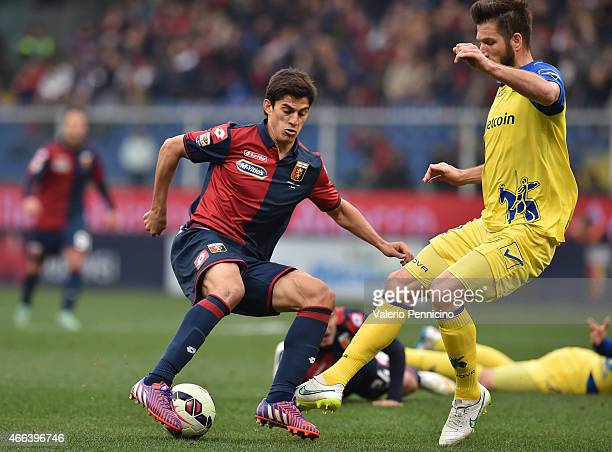 Diego Perotti of Genoa CFC is tackled by Bostjan Cesar of AC Chievo Verona during the Serie A match between Genoa CFC and AC Chievo Verona at Stadio...