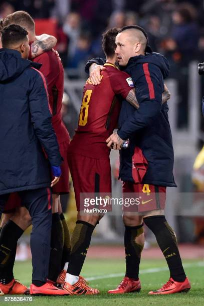 Diego Perotti of Roma and Radja Nainggolan of Roma celebrate the victory at the end of the Serie A match between Roma and Lazio at Olympic Stadium...