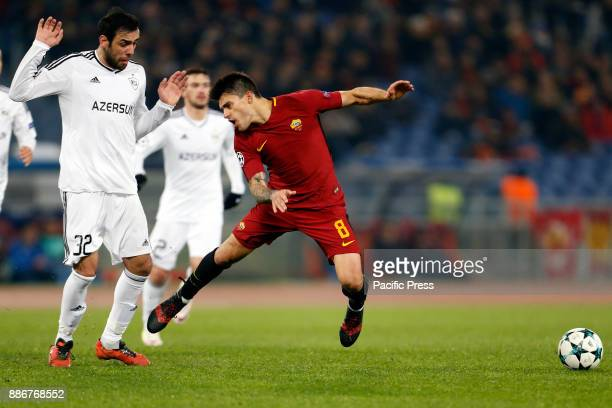 Diego Perotti of Roma fights for the ball against Elvin Yunuszada of Qarabag during the UEFA Champions League Group C soccer match in Rome Roma won...