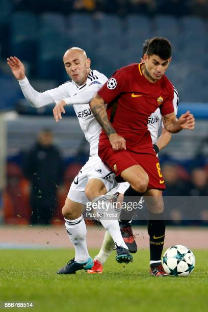 Diego Perotti of Roma fights for the ball against Richard Almeida of Qarabag during the UEFA Champions League Group C soccer match in Rome Roma won...