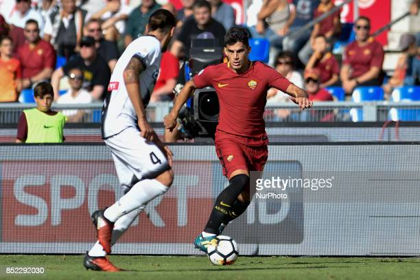 Diego Perotti of Roma is challenged by Gabriele Angella of Udinese during the Serie A match between Roma and Udinese at Olympic Stadium Roma Italy on...