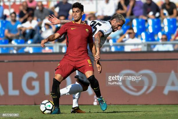 Diego Perotti of Roma is challenged by Valon Behrami of Udinese during the Serie A match between Roma and Udinese at Olympic Stadium Roma Italy on 23...