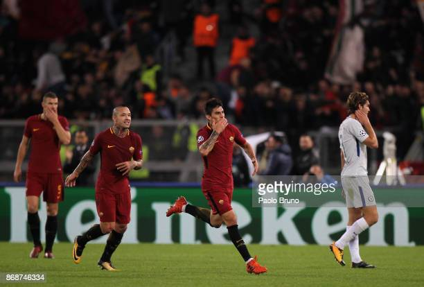 Diego Perotti with his teammate Radja Nainggolan of AS Roma celebrates after scoring the team's third goal during the UEFA Champions League group C...