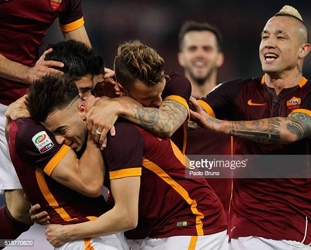Diego Perotti with his teammates of AS Roma celebrates after scoring the team's third goal during the Serie A match between AS Roma and ACF...