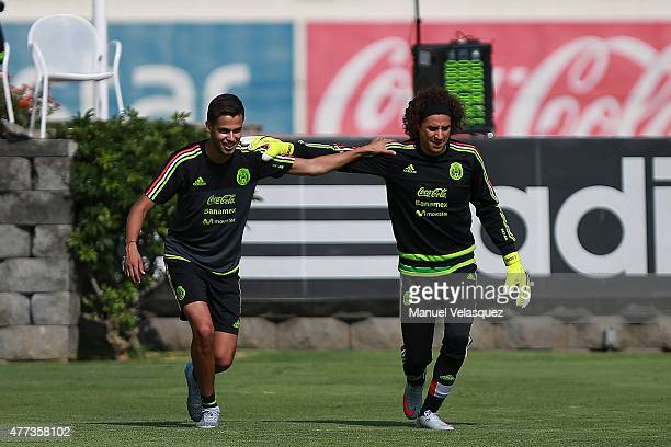 Diego Reyes and Guillermo Ochoa warm up during a Mexico National Team training session prior the beginning of Gold Cup 2015 at CAR on June 16 2015 in...