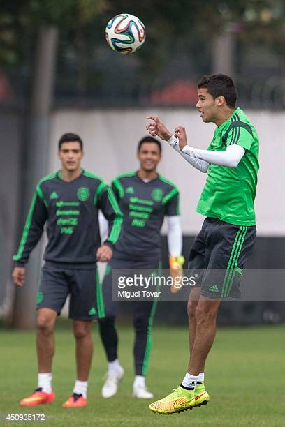 Diego Reyes heads the ball during a training session of Mexico at Estadio O´Rei Pele Training Center on June 20 2014 in Santos Brazil Mexico will...