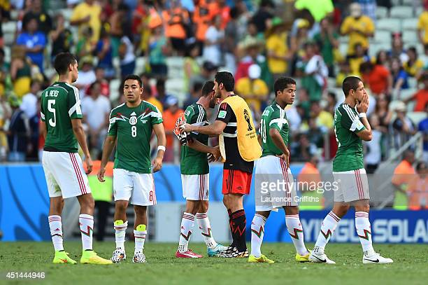 Diego Reyes Marco Fabian Miguel Layun Jose de Jesus Corona Giovani dos Santos and Javier Hernandez of Mexico look on after being defeated by the...