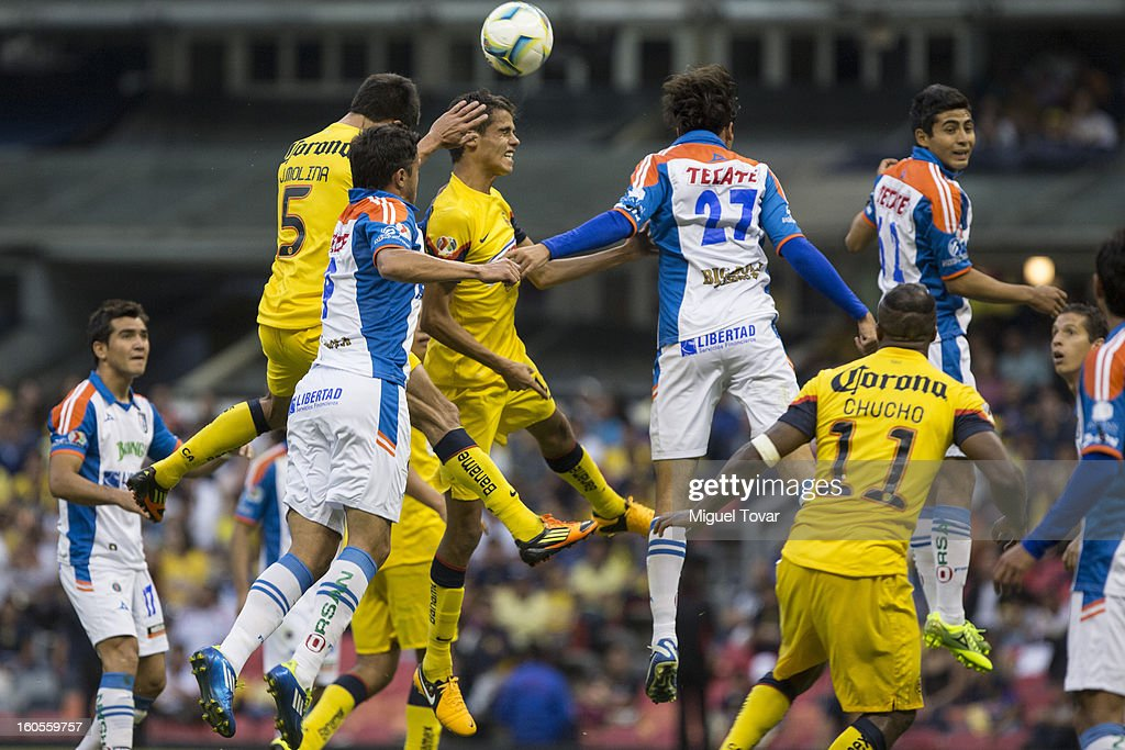 Diego Reyes of America jumps to heads the ball during a Clausura 2013 Liga MX match against Queretaro at Azteca Stadium on February 02, 2013 in Mexico City, Mexico.
