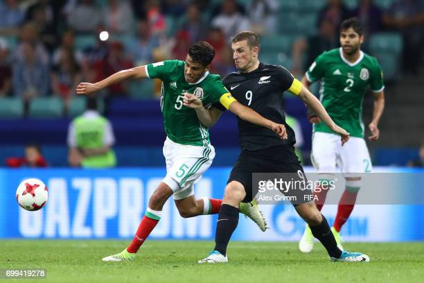 Diego Reyes of Mexico and Chris Wood of New Zealand battle for possession during the FIFA Confederations Cup Russia 2017 Group A match between Mexico...