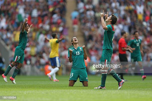 Diego Reyes of Mexico falls to his knees and celebrates winning the goal medal after victory in the Men's Football Final between Brazil and Mexico on...