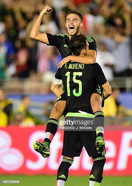 Diego Reyes of Mexico gestures as he jumps into the arms of Hector Moreno after defeating the USA during their 2015 CONCACAF Cup match at the Rose...