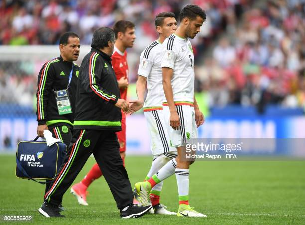 Diego Reyes of Mexico leaves the pitch after his injury during the FIFA Confederations Cup Russia 2017 Group A match between Mexico and Russia at...