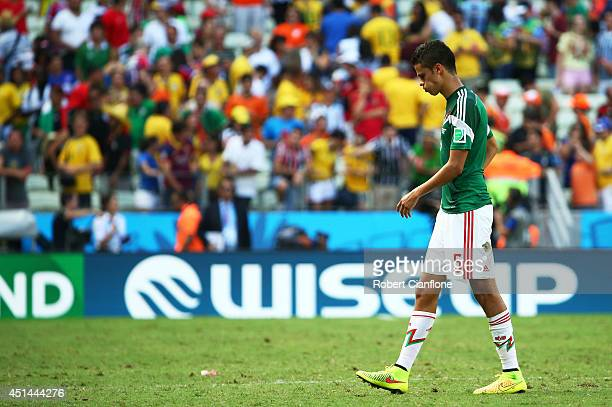 Diego Reyes of Mexico looks dejected after being defeated by the Netherlands in the 2014 FIFA World Cup Brazil Round of 16 match between Netherlands...