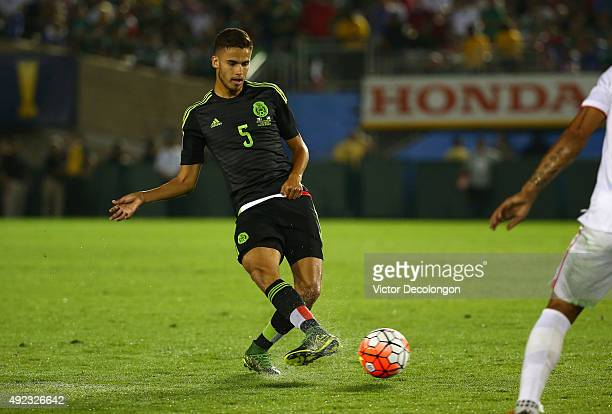 Diego Reyes of Mexico passes the ball against the United States during the 2017 FIFA Confederations Cup Qualifying match at Rose Bowl on October 10...
