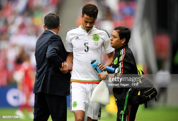 Diego Reyes of Mexico receives treatment from the medical team during the FIFA Confederations Cup Russia 2017 Group A match between Mexico and Russia...