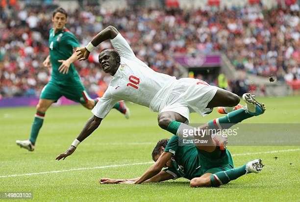 Diego Reyes of Mexico slides into Sadio Mane of Senegal during the Men's Football Quarter Final match between Mexico and Senegal on Day 8 of the...