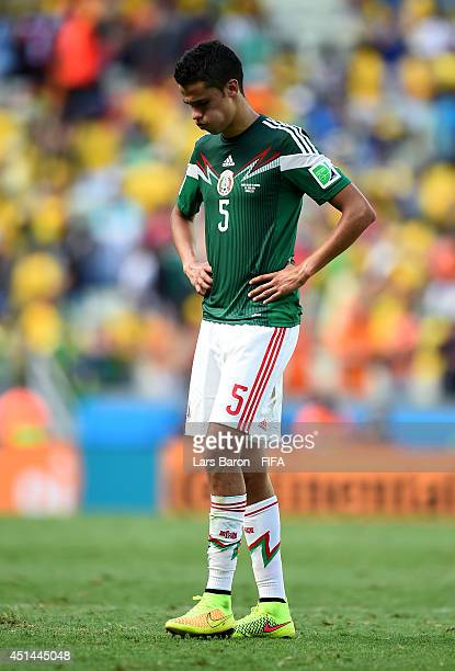 Diego Reyes of Mexico walks off the pitch after the 12 defeat in the 2014 FIFA World Cup Brazil Round of 16 match between Netherlands and Mexico at...