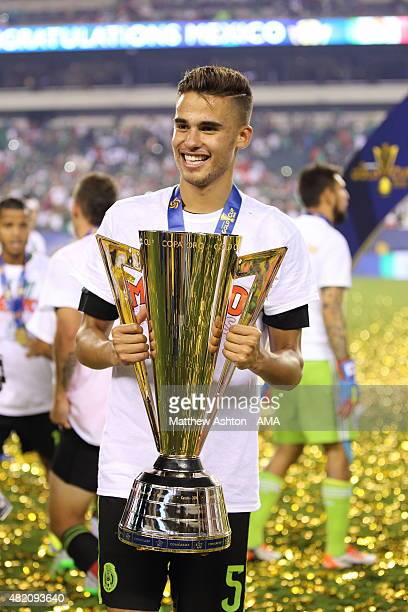 Diego Reyes of Mexico with The CONCACAF Gold Cup Trophy during the celebrations after the 2015 CONCACAF Gold Cup Final match between Jamaica and...