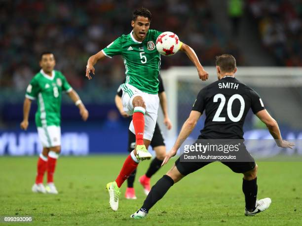 Diego Reyes ofMexico attempts to take the ball past Tommy Smith of New Zealand during the FIFA Confederations Cup Russia 2017 Group A match between...