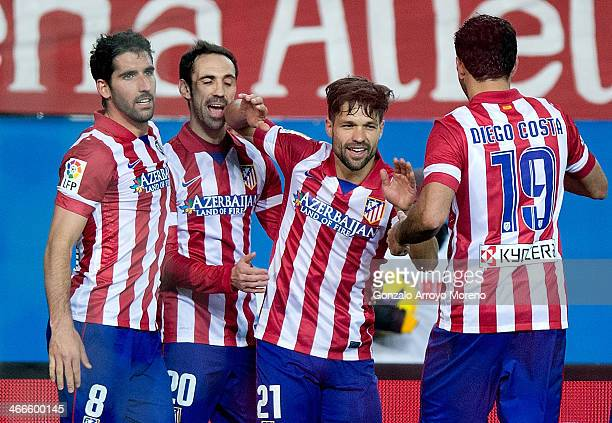 Diego Ribas celebrates scoring their fourth goal with teammates Diego Costa Juan Francisco Torres alias Juanfran and Raul Garcia during the La Liga...