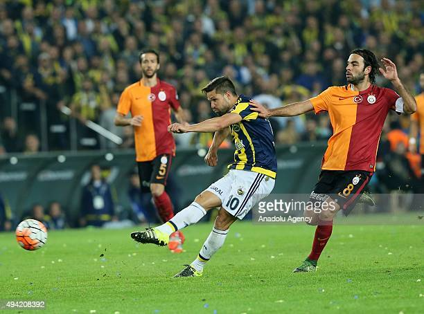 Diego Ribas Da Cunha of Fenerbahce in action against Selcuk Inan of Galatasaray during the Turkish Spor Toto Super League football match between...