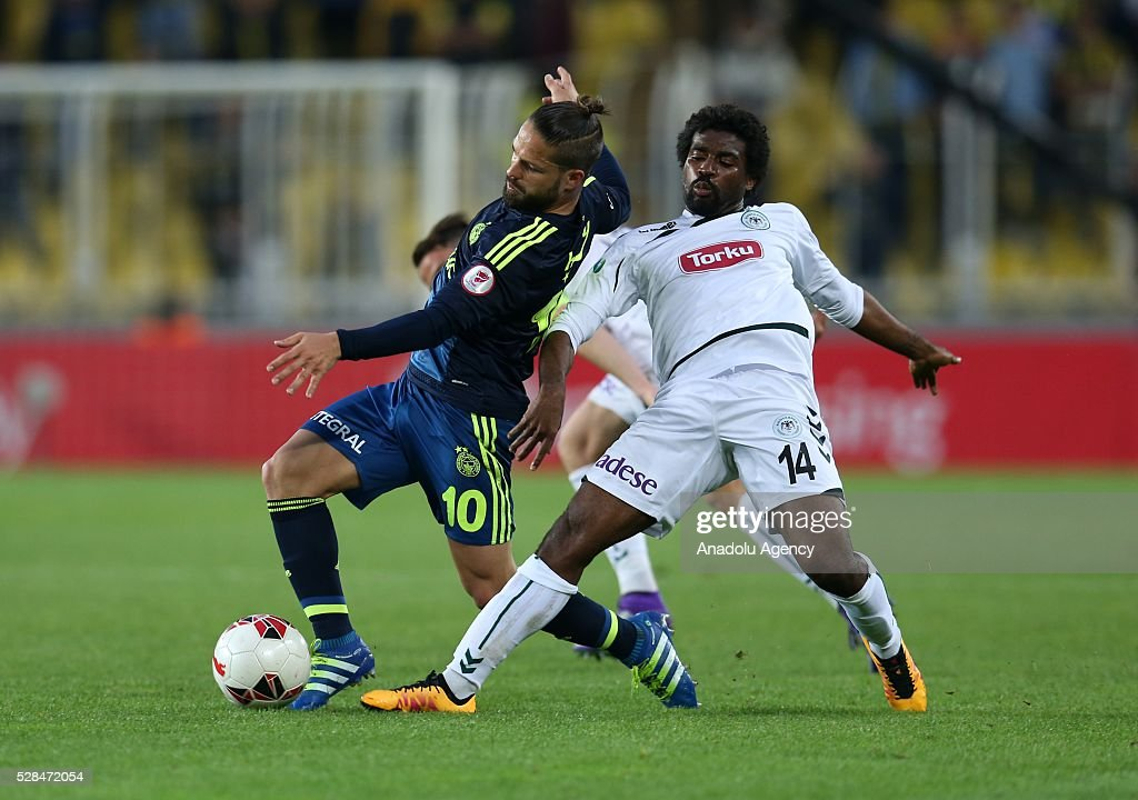 Diego Ribas (L) of Fenerbahce and Mbamba of Torku Konyaspor vie for the ball during the during Ziraat Turkish Cup Semi Final second leg football match between Fenerbahce and Torku Konyaspor at Ulker Stadium in Istanbul, Turkey on May 5, 2016.