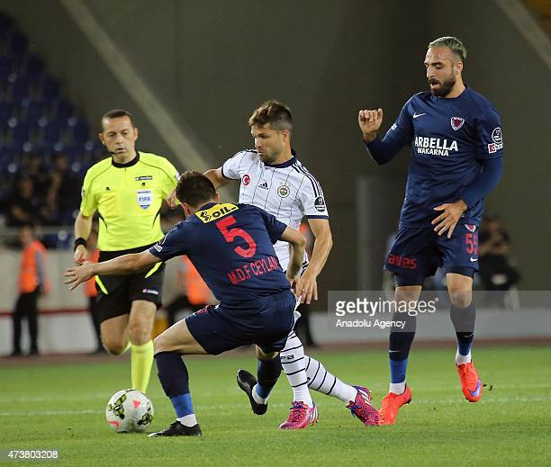 Diego Ribas of Fenerbahce vies for the ball with Murat Ceylan of Mersin Idmanyurdu during the Turkish Spor Toto Super League football match between...