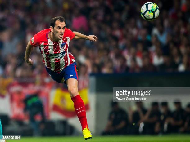 Diego Roberto Godin Leal of Atletico de Madrid heads the ball during the La Liga 201718 match between Atletico de Madrid and FC Barcelona at Wanda...