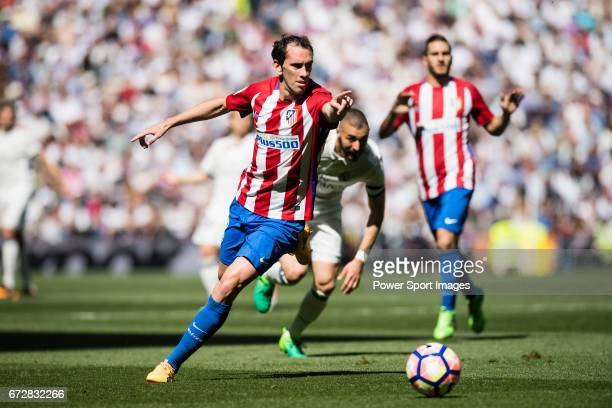 Diego Roberto Godin Leal of Atletico de Madrid in action during their La Liga match between Real Madrid and Atletico de Madrid at the Santiago...