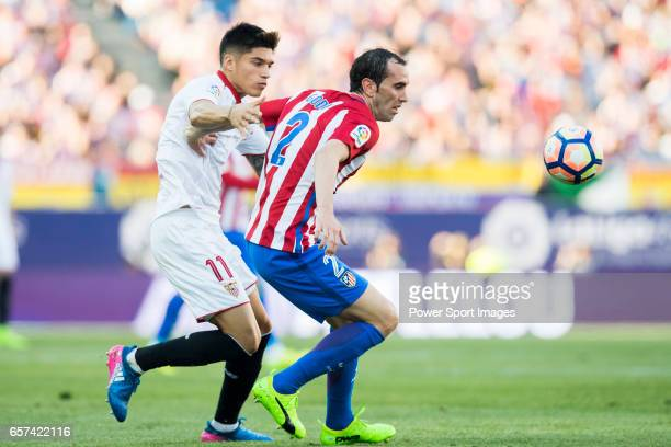 Diego Roberto Godin Leal of Atletico de Madrid is challenged by Carlos Joaquin Correa of Sevilla FC during their La Liga match between Atletico de...