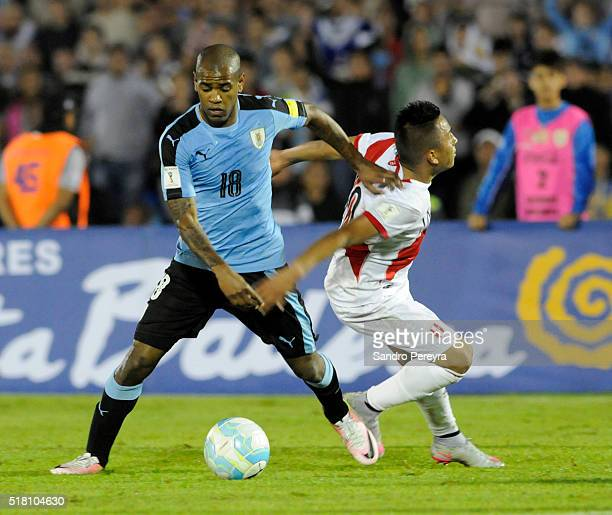 Diego Rolan of Uruguay and Christian Cueva of Peru fight for the ball during a match between Uruguay and Peru as part of FIFA 2018 World Cup...