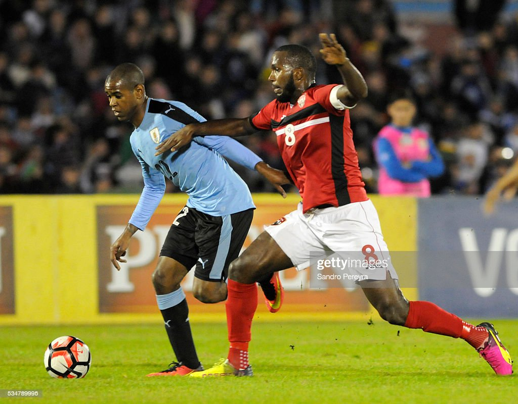 Diego Rolan of Uruguay and <a gi-track='captionPersonalityLinkClicked' href=/galleries/search?phrase=Khaleem+Hyland&family=editorial&specificpeople=5366394 ng-click='$event.stopPropagation()'>Khaleem Hyland</a> of Trinidad Tobago fight for the ball during an international friendly match between Uruguay and Trinidad & Tobago at Centenario Stadium on May 27, 2016 in Montevideo, Uruguay.