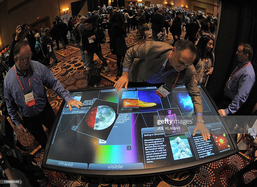Diego Romeu of 3M Touch Systems shows 84 inch touch table during the opening event ''CES Unveiled'' during the International Consumer Electronics Show (CES) in Mandalay Bay Hotel resort on January 06, 2013 in Las Vegas, Nevada.