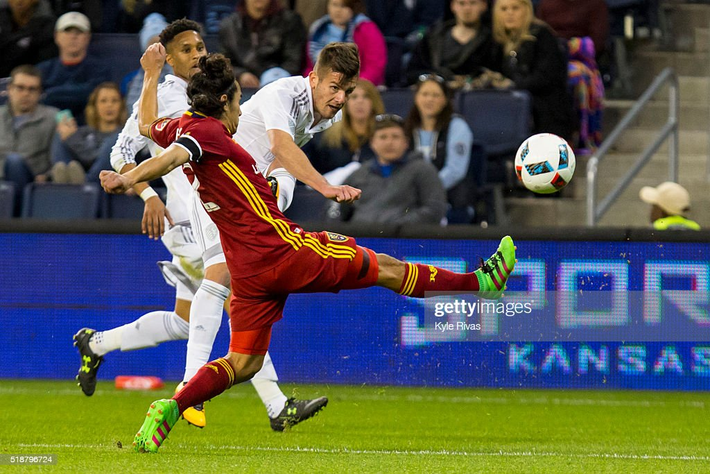 Diego Rubio #9 of Sporting Kansas City takes a shot past the leg of Tony Beltran #2 of Real Salt Lake in the second half on April 2, 2016 at Children's Mercy Park in Kansas City, Kansas.