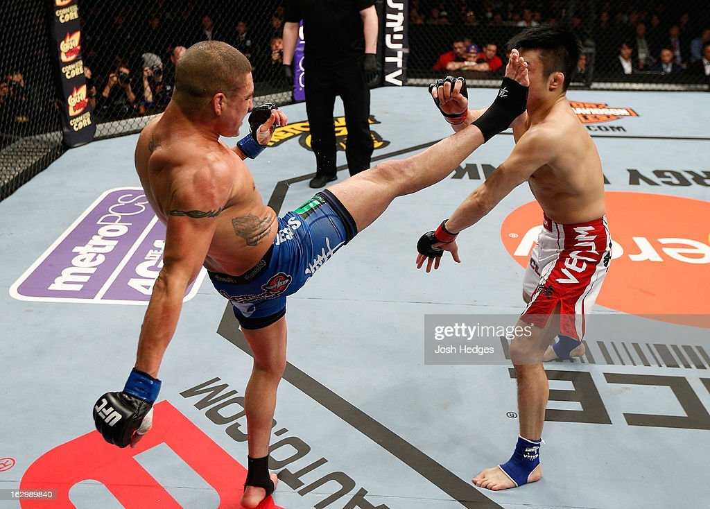Diego Sanchez kicks Takanori Gomi in their lightweight fight during the UFC on FUEL TV event at Saitama Super Arena on March 3, 2013 in Saitama, Japan.