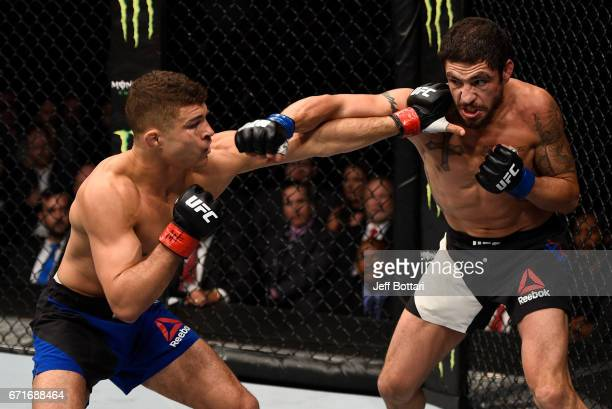 Diego Sanchez punches Al Iaquinta in their lightweight bout during the UFC Fight Night event at Bridgestone Arena on April 22 2017 in Nashville...