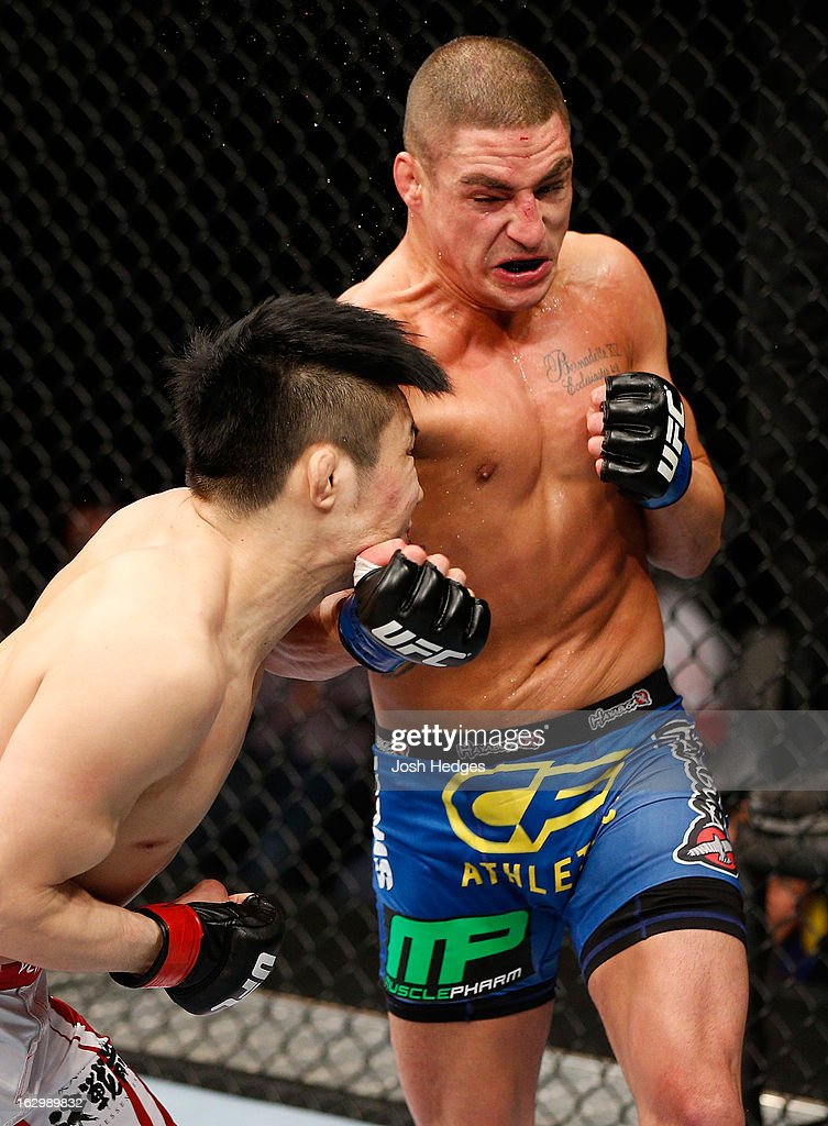 Diego Sanchez punches <a gi-track='captionPersonalityLinkClicked' href=/galleries/search?phrase=Takanori+Gomi&family=editorial&specificpeople=7075932 ng-click='$event.stopPropagation()'>Takanori Gomi</a> in their lightweight fight during the UFC on FUEL TV event at Saitama Super Arena on March 3, 2013 in Saitama, Japan.
