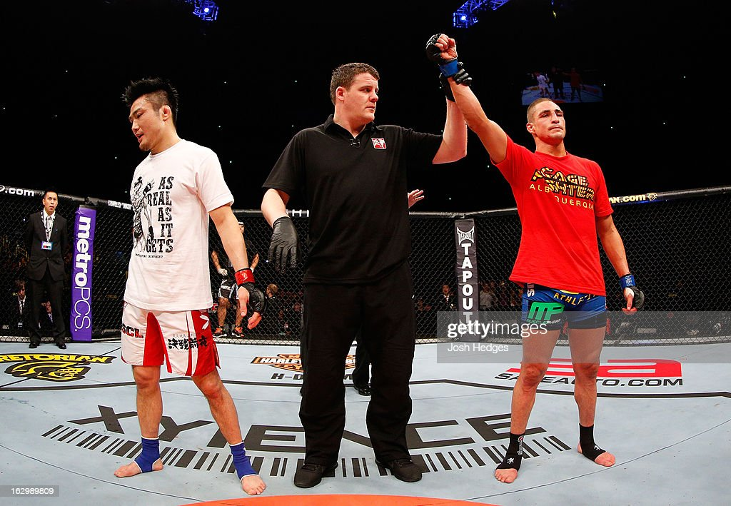Diego Sanchez (R) reacts after defeating <a gi-track='captionPersonalityLinkClicked' href=/galleries/search?phrase=Takanori+Gomi&family=editorial&specificpeople=7075932 ng-click='$event.stopPropagation()'>Takanori Gomi</a> (L) in their lightweight fight during the UFC on FUEL TV event at Saitama Super Arena on March 3, 2013 in Saitama, Japan.